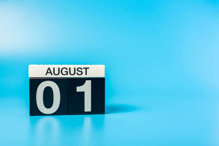 August 1st. Image of 1 august color calendar on blue background. Summer day. Empty space for text 写真素材