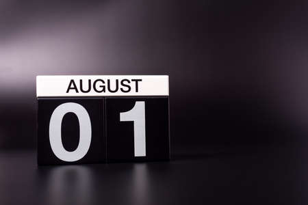 August 1st. Image of 1 august color calendar on black background. Summer day. Empty space for text