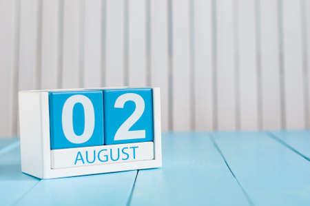 August 2nd. Image of august 2 wooden color calendar on blue background. Summer day. Empty space for text 写真素材