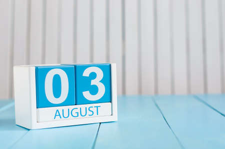 August 3rd. Image of august 3 wooden color calendar on blue background. Summer day. Empty space for text