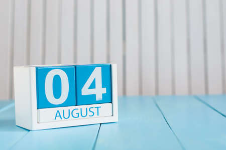 August 4th. Image of august 4 wooden color calendar on blue background. Summer day. Empty space for text