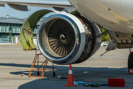 Engines maintenance in airport. Repair and preparation of the aircraft before departure