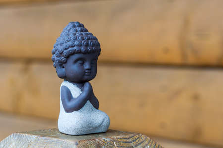 Little Buddha statue image used as amulets of Buddhism religion. Meditation concept with empty space for text Stockfoto