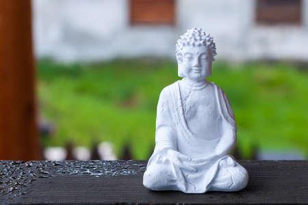 Figure of Buddha on blurred background. Meditation concept. Stockfoto
