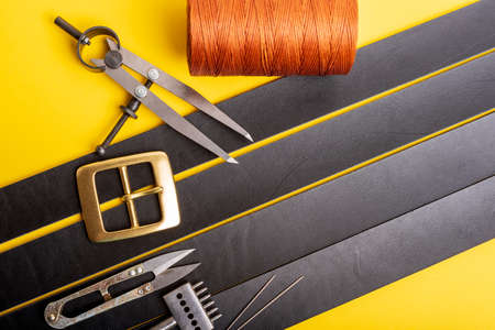 Leather crafting tools still life. Tanners workshop. The concept of small, private business.