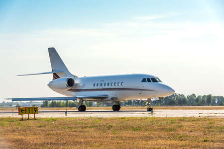 Business private jet airplane on airfield. Preparing for take-off. Business and power concept. Stockfoto