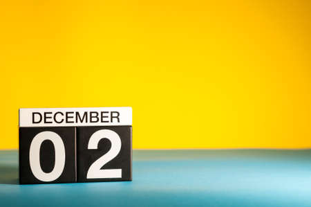 December 2nd. Image 1 day of december month, calendar on yellow background. Winter background with empty space for text, mockup.