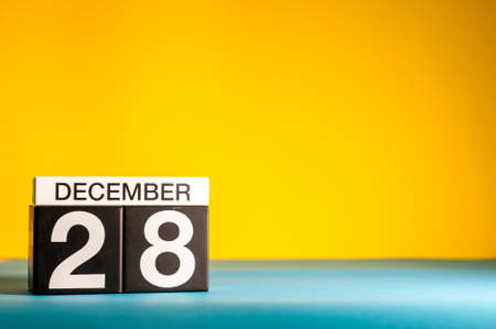 December 28th. Image 28 day of december month, calendar on yellow background with empty space for text