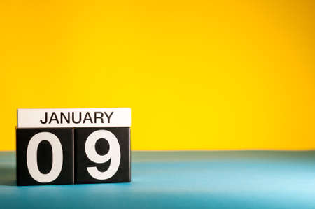 January 9th. Day 9 of january month, calendar on yellow background. Winter time. Empty space for text