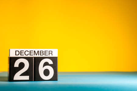 December 26th. Image 26 day of december month, calendar on yellow background with empty space for text