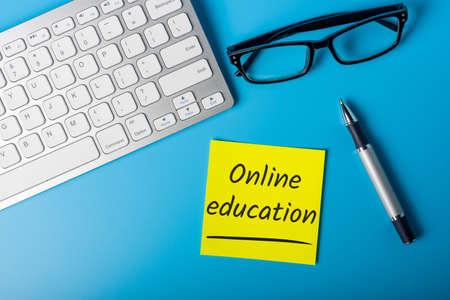 Online Education - self-learning tendency through renowned university courses and programs. Фото со стока