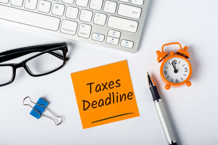 Taxes deadline or tax time - Notification of the need to file tax returns, tax form at accauntant workplace