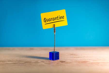 Quarantine - tag on office table with word quarantine. Pandemic Covid-19 Coronavirus quarantine concept