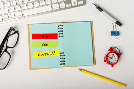 Are you covered - message on insurer or underwriter workplace. Insurance concept