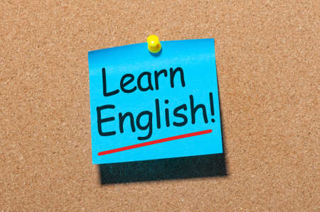 Learn english - note at corkboard background. New opportunities with new skill