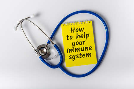 How to help your immune system - message on notepad near Stethoscope. Boost immune system as medical concept. Stok Fotoğraf