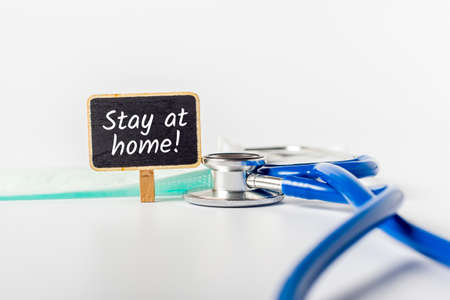 Stethoscope and doctors advice to stay at home. Quarantine or shelter in place during illness. Pneumonia Covid-19