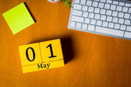 May 1st. Day 1 of may month, calendar on office table, workplace. Spring time