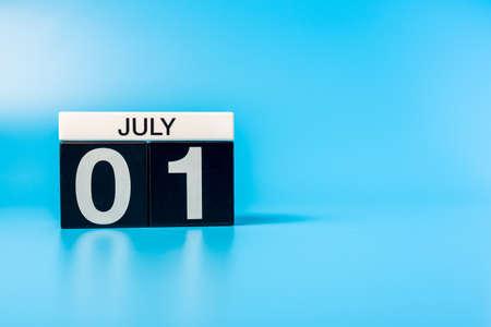 July 1st. Image of july 1 desk calendar on blue background. Summer day. Empty space for text Standard-Bild