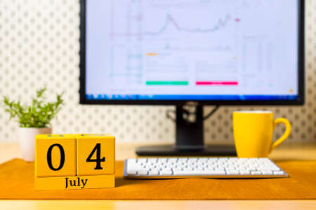 July 4th. Image of july 4 wooden color calendar on office background. Summer day. Day off. Independence Day Of America