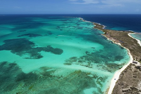 Caribbean sea, Los Roques: Vacation travel on blue sea and paradisiac islands. Dream. Tropical vacation. Tropical travel. Great beach scenery. Beautiful landscape. Travel scenery. Vacation scenery. Deserted beaches. Tranquility, recreation scene.