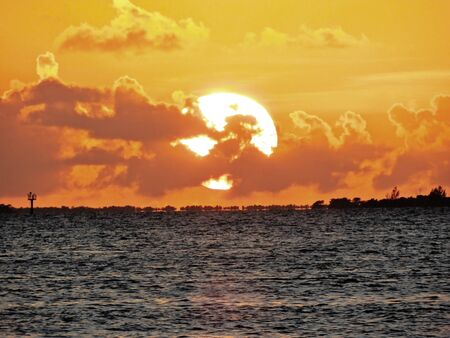 Sunset view from famous Mallory Square in Key West, Florida, United States. Great landscape. Fantastic Sunset's scenery. Tourism point.