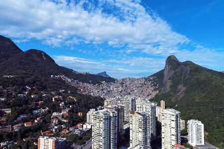 Aerial view of Rocinha's Community, Rio de Janeiro city in the sunny day, Brazil. Great landscape.