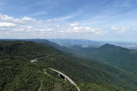 Aerial view of famous Imigrantes's Road in the saw. Great landscape between mountains. Serra do Mar's State Park, Sao Paulo, Brazil Archivio Fotografico - 150293568