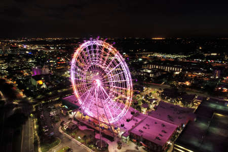 Aerial view of park at night with beautiful ferris wheel and attractions. Great landscape! Orlando, Florida, United States of America