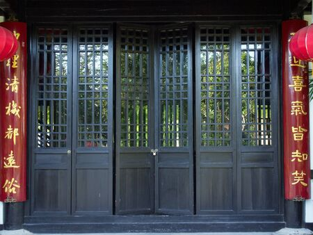 old black chinese style wood door Stock Photo