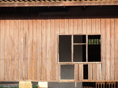 blanked: blanked windows on old wood wall