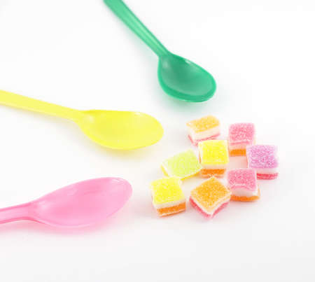 yello: Colorful sweet jelly and spoons Stock Photo