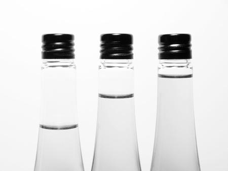 Different liquid level in bottle, monotone color