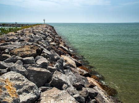 rock sea wall and ocean Stock Photo - 21992690