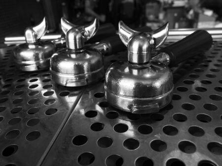coffee machines: Portafilter on top of espresso machine, coffee shop, monotone color