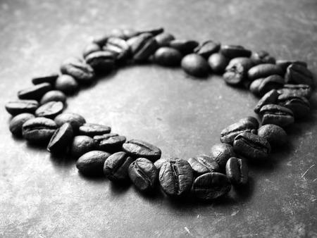 arabica: Roasted Arabica Coffee Bean, monotone backgroun Stock Photo