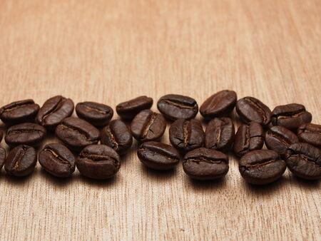 arabian food: Roasted Coffee Beans on wood texture table Stock Photo