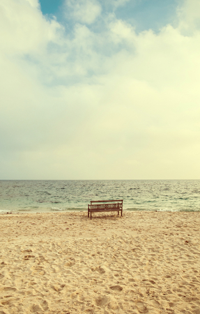 bench on sand beach, vintage color