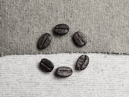 monotone: Roasted Coffee Beans on fabric textile, monotone color