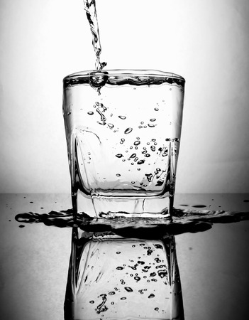 pouring water to glass photo