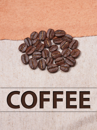 coffee crop beans on fabric textile texture background photo