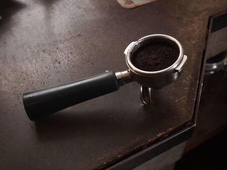 tamper: Coffee in portafilter and tamper for espresso machine Stock Photo