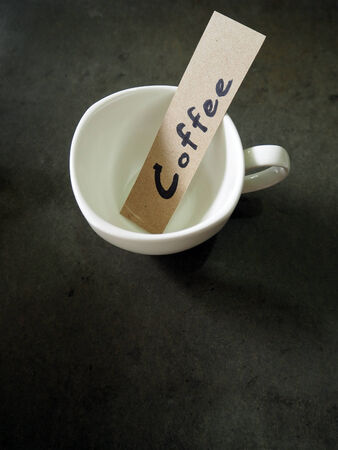 coffee text on paper in a cup background