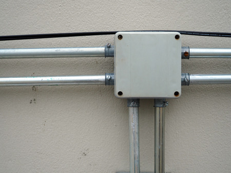 junction pipe: electrical junction box with galvanized conduit pipe connection  Stock Photo