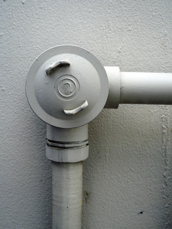 Galvanized steel pipe with tee, elbow, fitting and valve, water piping system Stock Photo