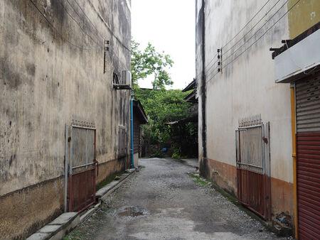 road path between antique building