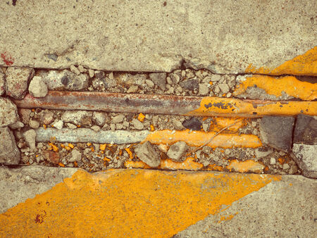 crack pipe: crack concrete floor with corroded pipe , vintage color background texture
