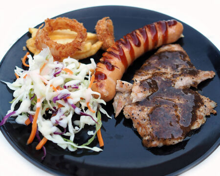 Pork steak with pork sausage and salad photo