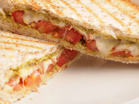 Whole wheat bread Bacon pesto and mozzarella panini photo