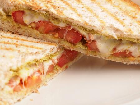 Whole wheat bread Bacon pesto and mozzarella panini photo